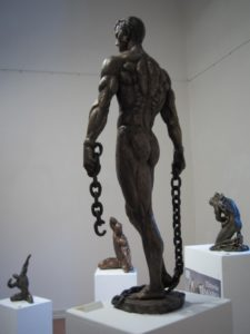 Bronze statues sculptures Towards New Spaces muscular man with two chains