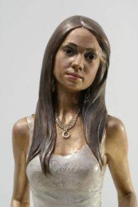 Customized bronze sculptures woman dominican girl Carmen sitting with handbag