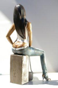 Custom bronze statue woman dominican girl Carmen sitting with handbag