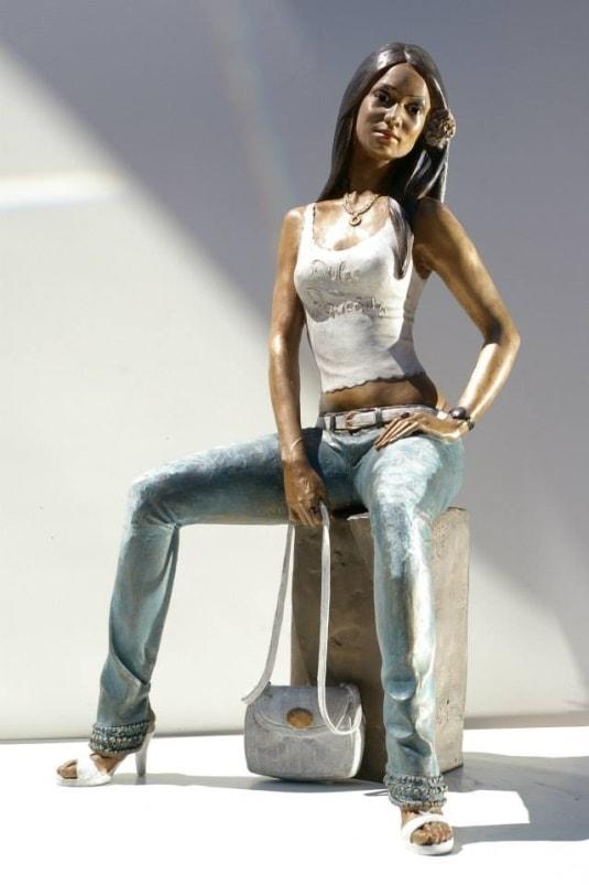Customized bronze sculpture woman dominican girl Carmen sitting with handbag